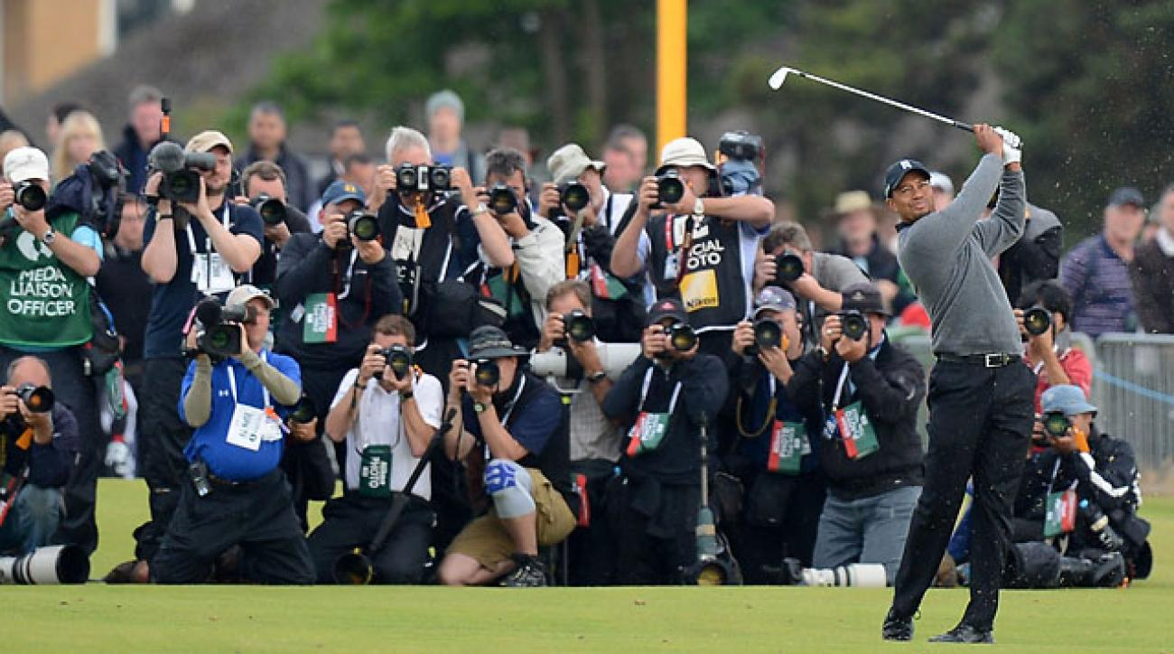 Photographers shoot Tiger Woods during the second round of the 2012 Open Championship at Royal Lytham & St Annes Golf Club.