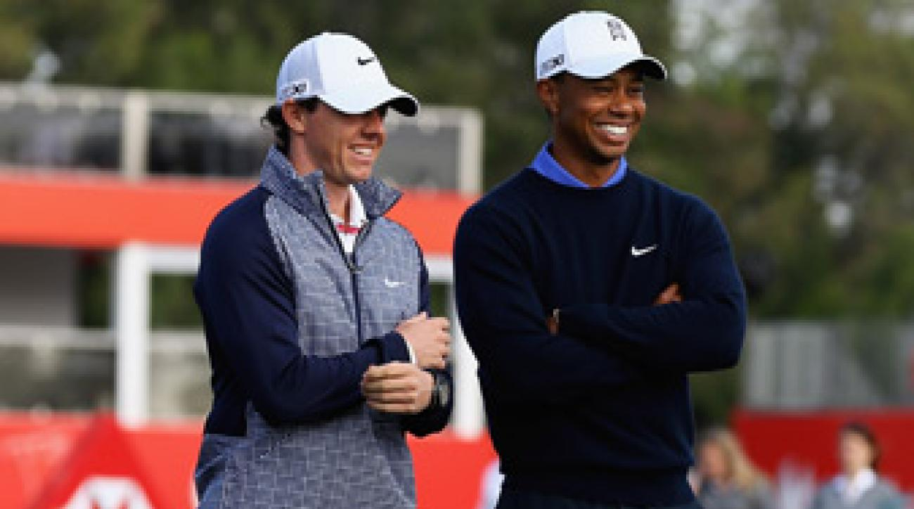 Tiger Woods, right, and Rory McIlroy will be paired together at the Abu Dhabi Championship.