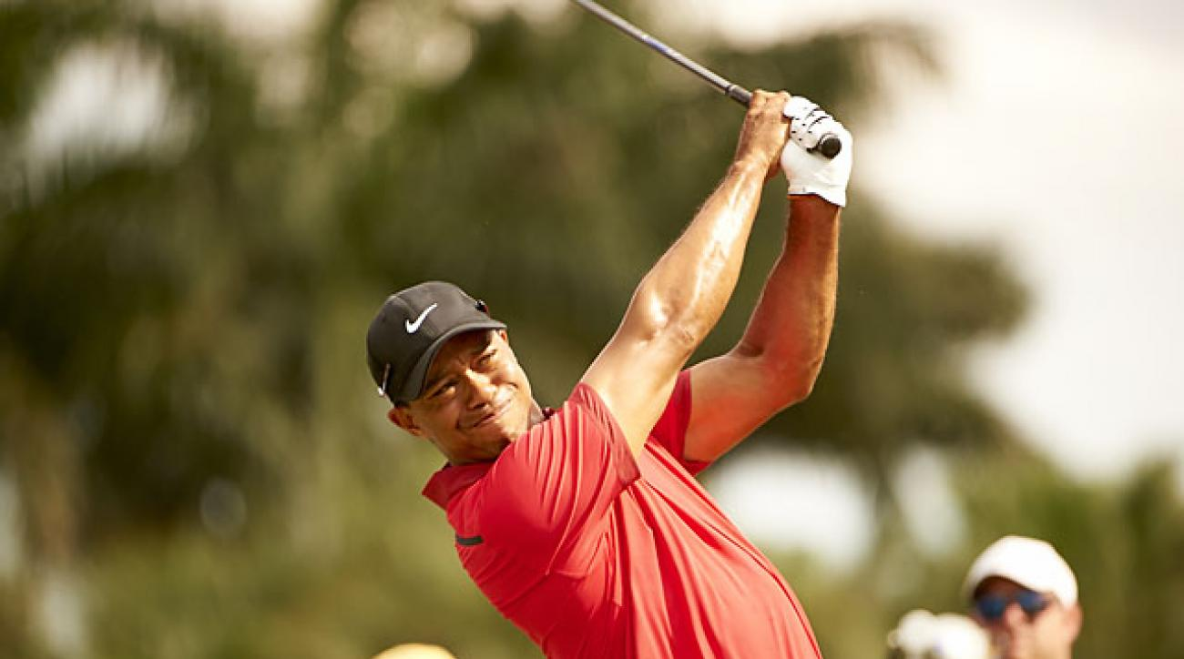 Tiger Woods hits a shot in the final round of the Cadillac Championship on March 9. It was his last competitive round before his back surgery on March 31.