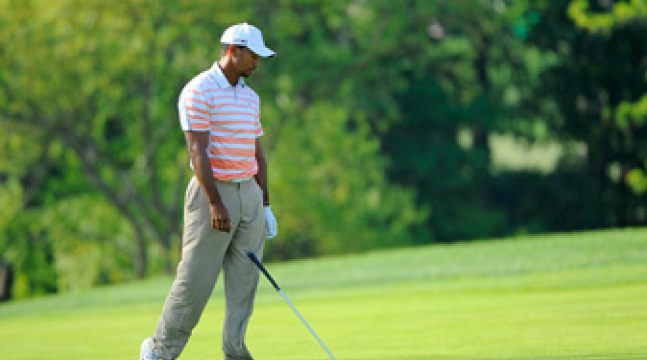 Tiger Woods made two birdies, two bogeys and a double bogey on Friday.