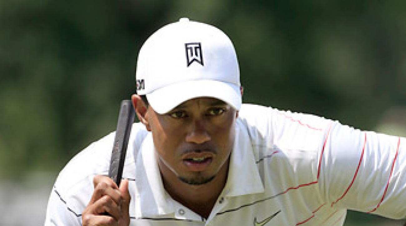 Woods took 33 putts in the first round.