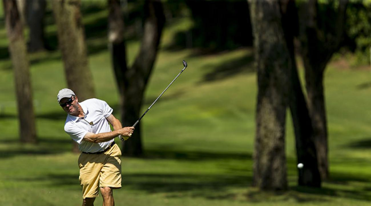 Sports Illustrated's Gary Van Sickle plays his third shot on the sixth hole during the first round of stroke play at the 2014 USGA Senior Amateur at Big Canyon Country Club in Newport Beach, Calif., on Saturday.