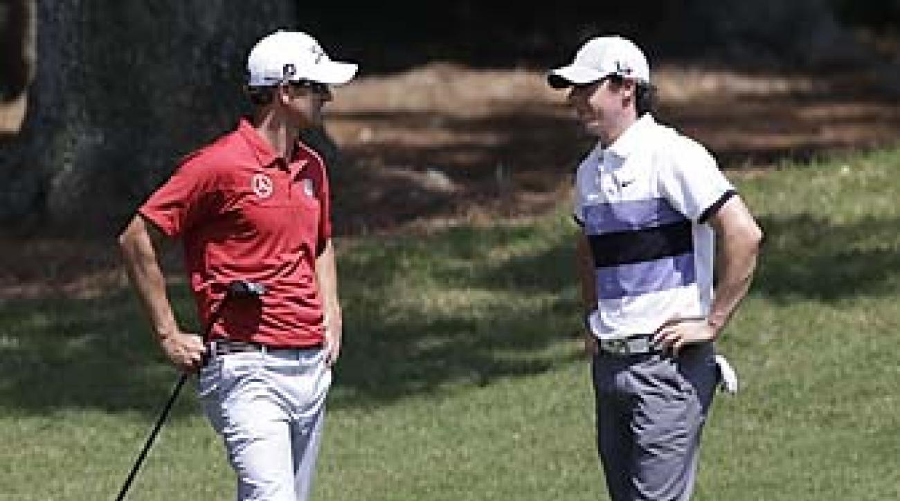 Adam Scott and Rory McIlroy chat during their first round at TPC Sawgrass on Thursday morning.