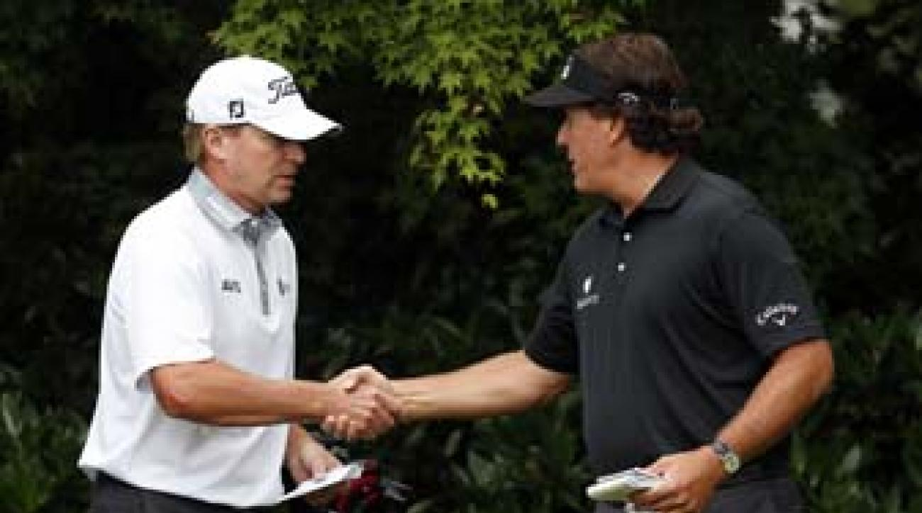 Steve Stricker and Phil Mickelson talk during the first round of the 2013 U.S. Open at Merion. Both Mickelson and Stricker finished in the top 10 in the tournament.