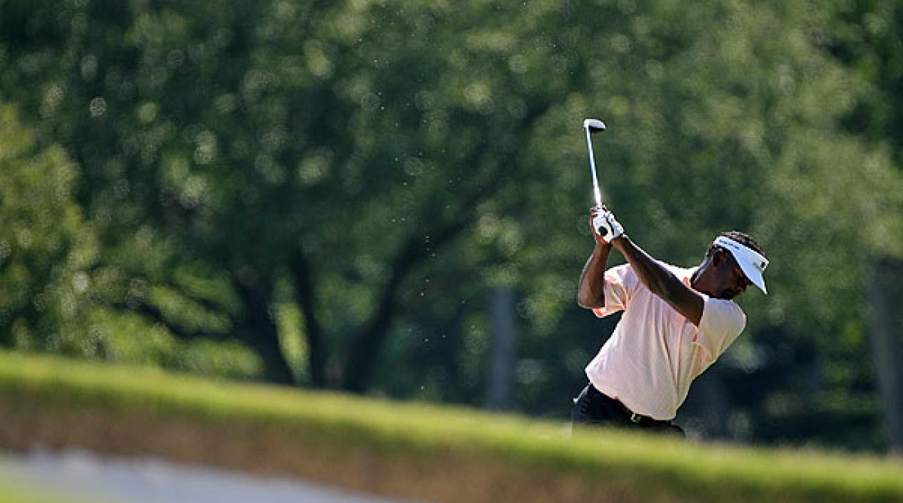Vijay Singh, who hasn't been to Colonial since Annika Sorenstam played there in 2003, is one stroke off the lead.