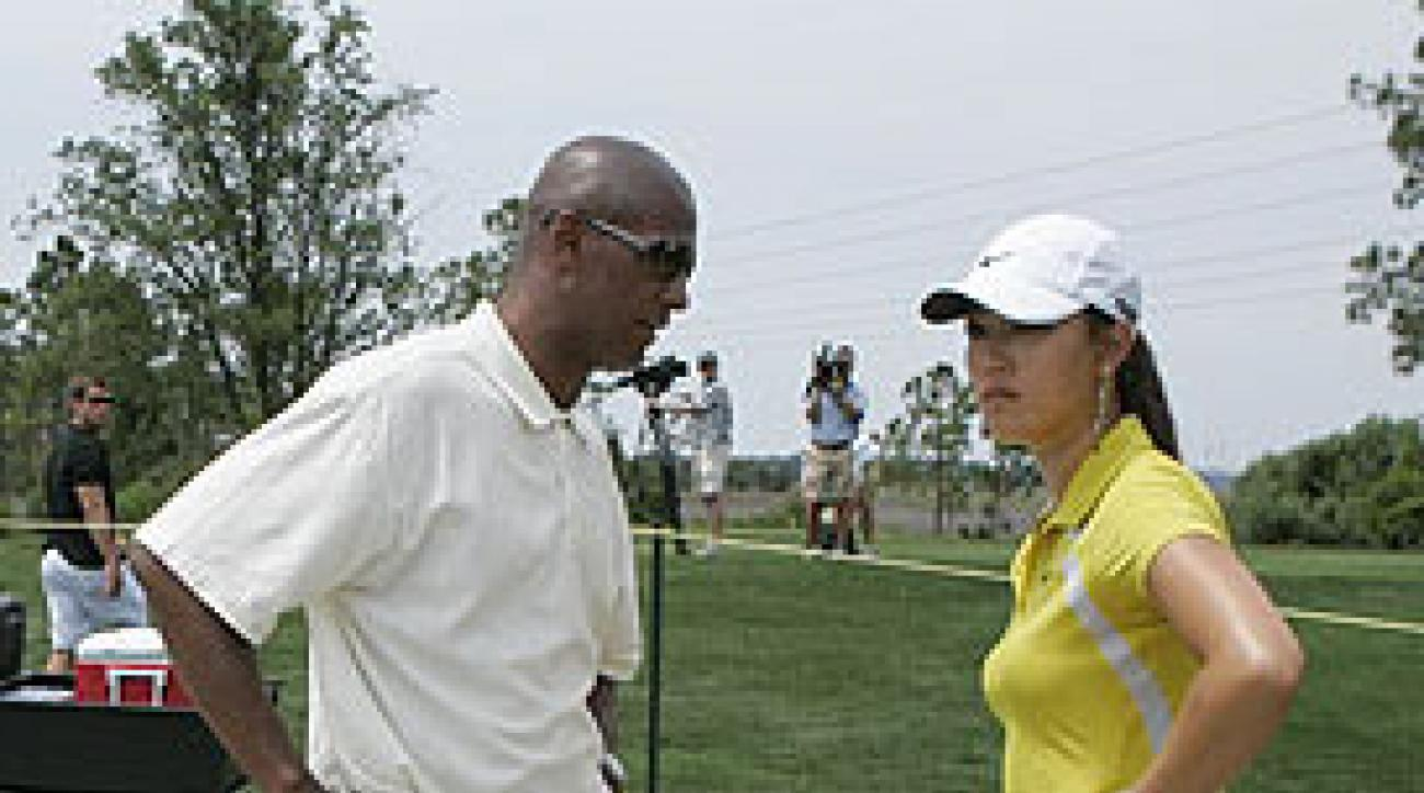After speaking with her then-agent, Greg Nared (left), Wie said she could not continue at the 2007 Ginn Tribute because of her injured wrist.