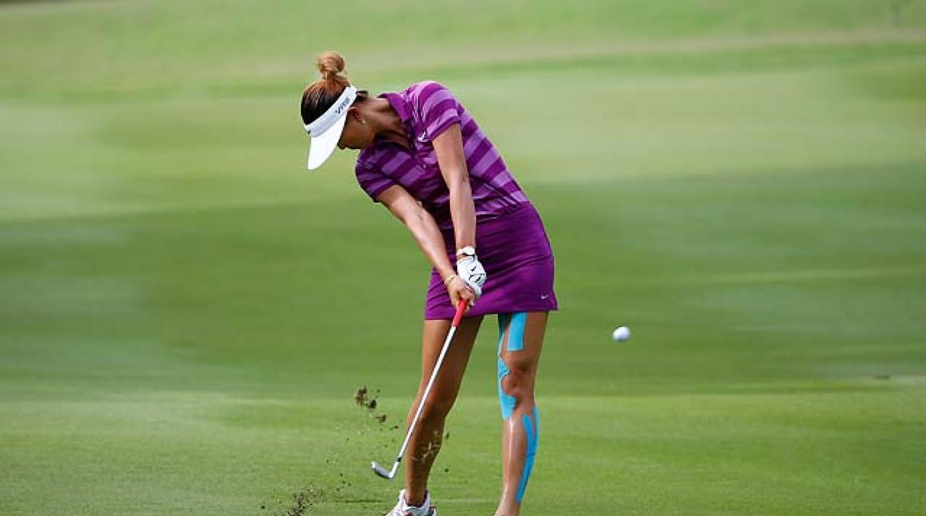 Michelle Wie strikes an iron shot at the NW Arkansas Championship on Saturday.