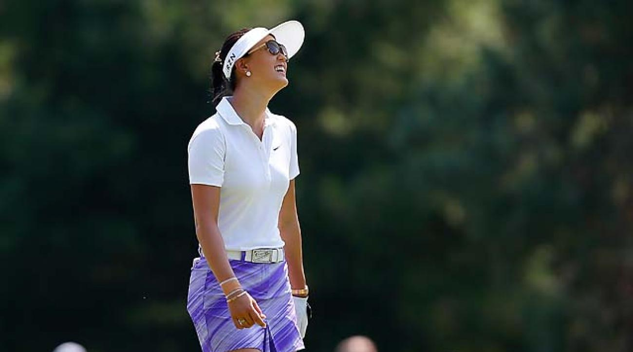 Michelle Wie laughs as she walks down the fairway on the first hole during the first round of the Meijer LPGA Classic at Blythefield Country Club on Friday in Belmont, Mich.