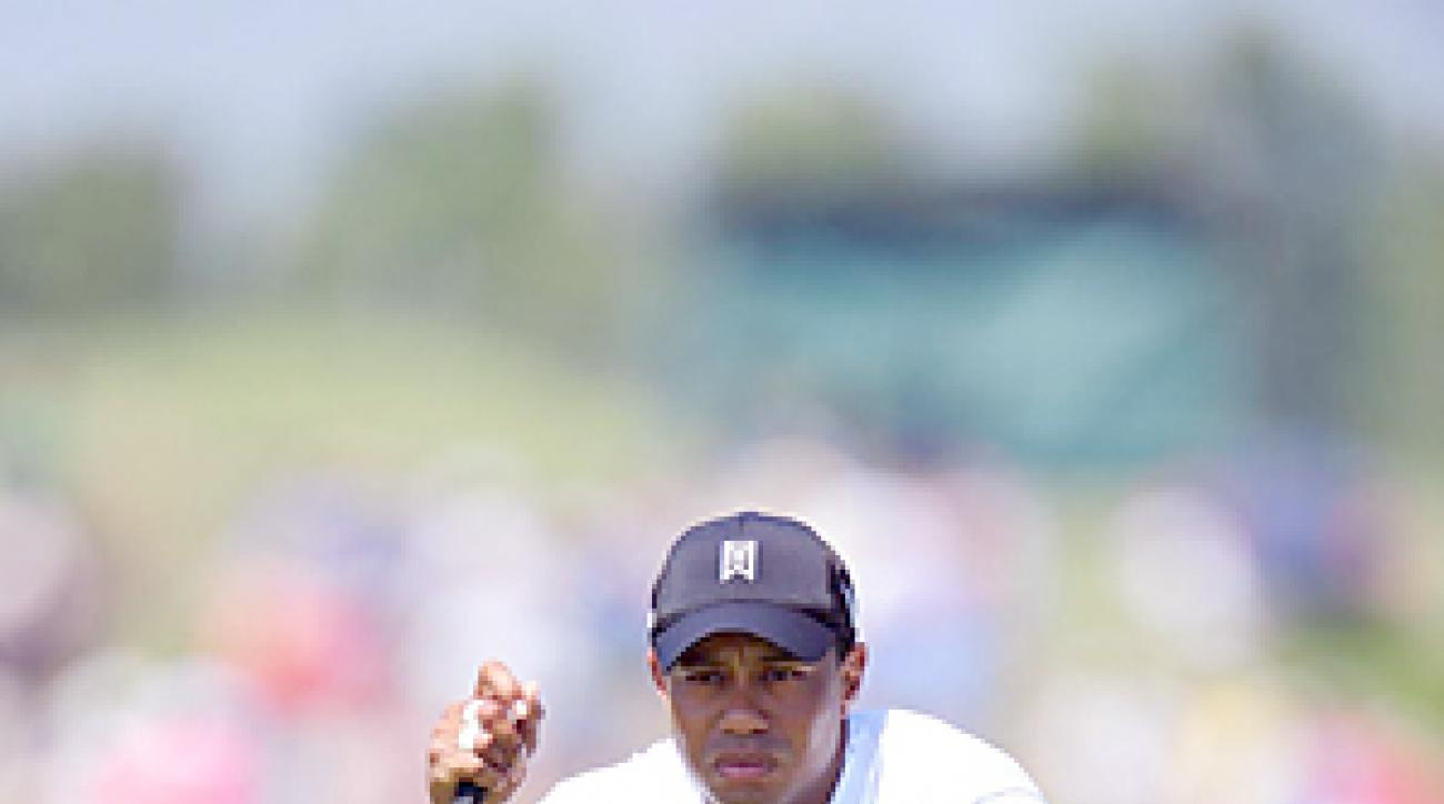 Tiger Woods birdied No. 9, his last hole of the day, for a one-under 71.