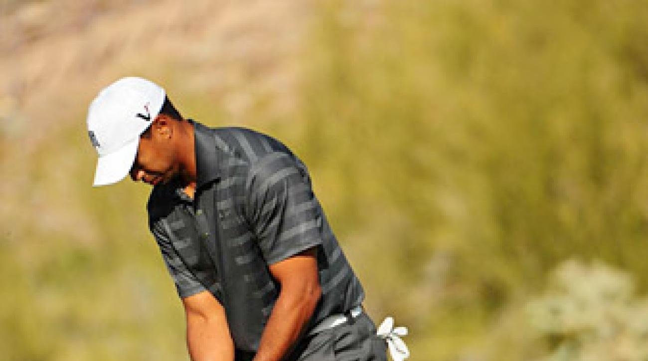 Tiger Woods missed a five-foot putt on 18 to lose to Nick Watney.