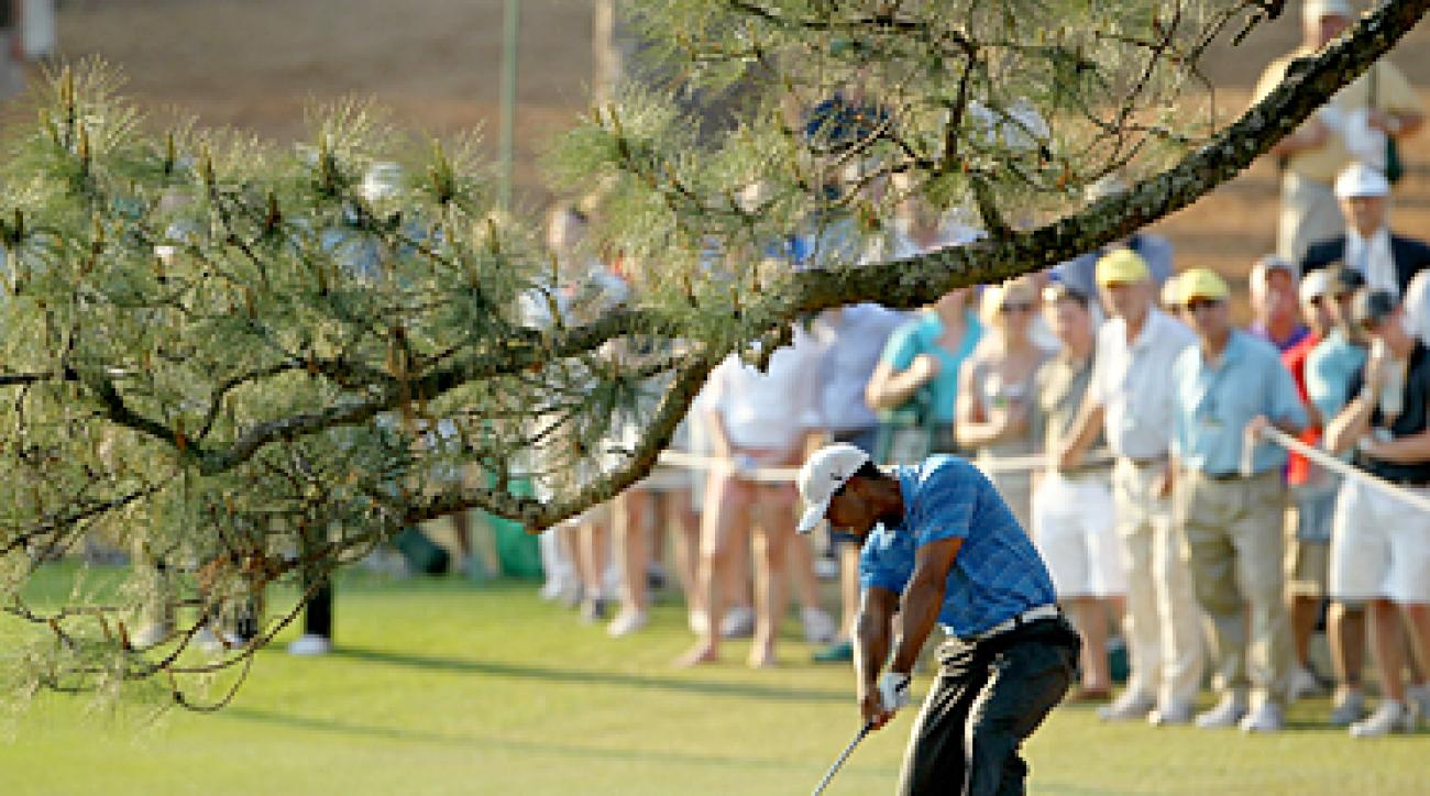 Tiger Woods says he injured his left knee and Achilles tendon on this shot in the third round at the 2011 Masters.