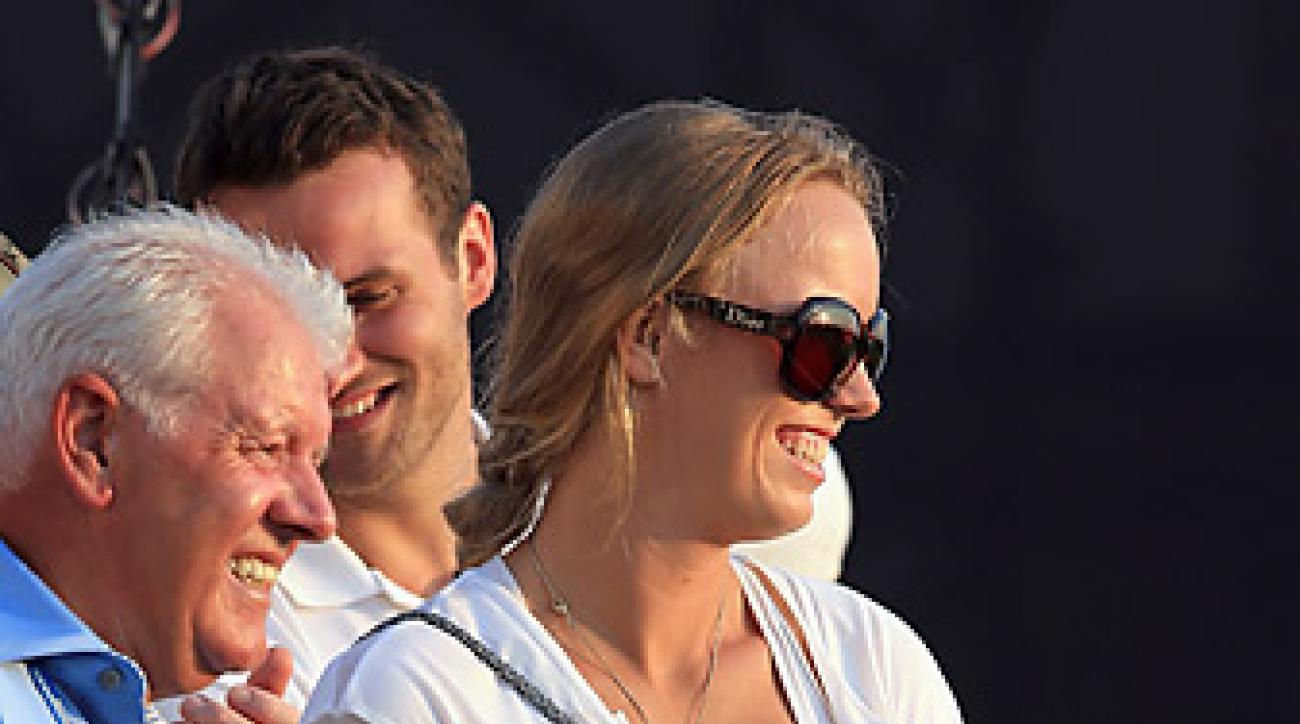 Caroline Wozniacki showed up at boyfriend Rory McIlroy's press conference to ask him a few questions.
