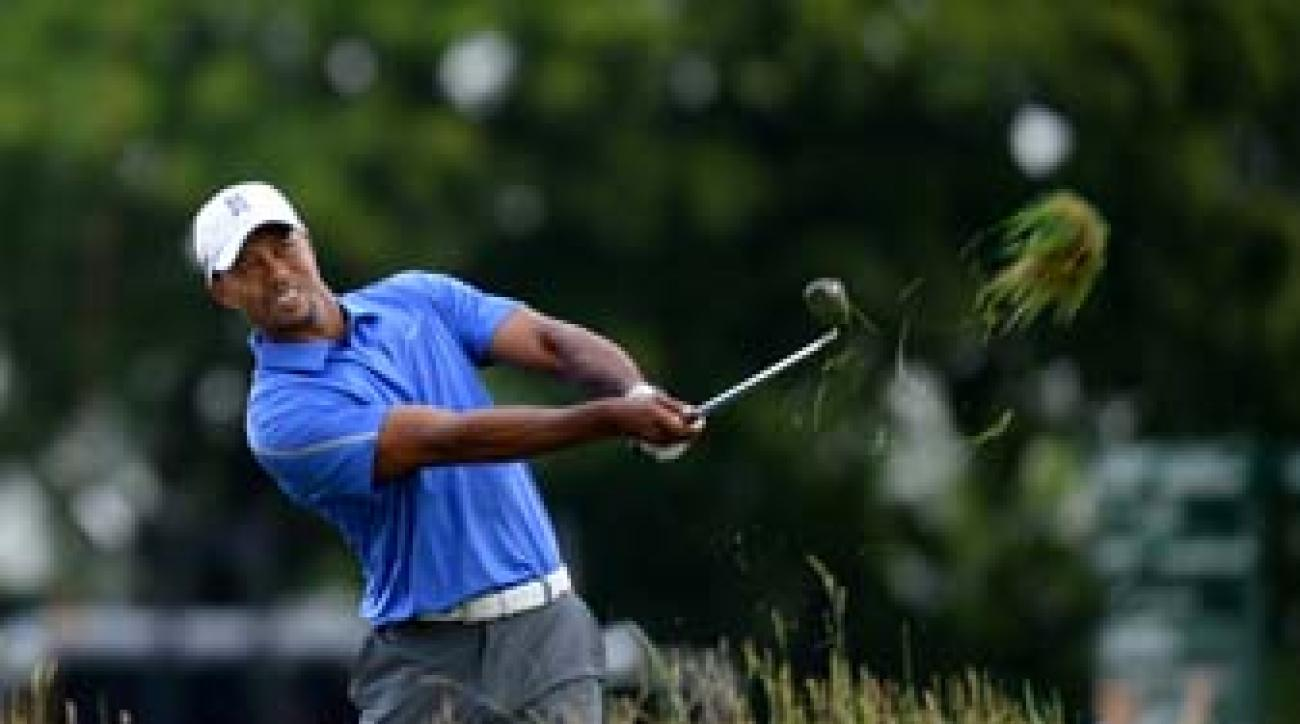 Tiger Woods hits from the thick rough on the first hole at Merion Golf Club on Thursday.