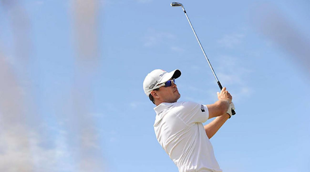 Zach Johnson leads by himself after an opening-round five-under 66.