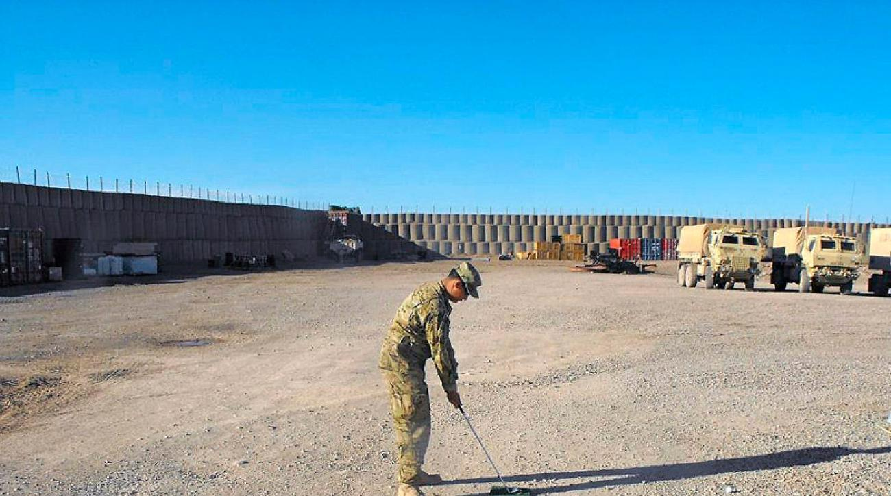 """Tour pros who think the Bear's Trap is difficult should try Shindand Air Base's par 3 in Afghanistan, which Army Specialist Jason Cates nominates as the World's Most Dangerous Hole. """"Try putting for par when you have mortar rounds going off around you,"""" he says. We'll take his word for it!                                                                      Army Specialist Jon Lindemann prepares to tee off on the first tee at Shindand Air Base's Par 3, aka the """"World's Most Dangerous Hole."""" This is one of three tee locations -- the hole can play 148, 125 or 106 yards."""