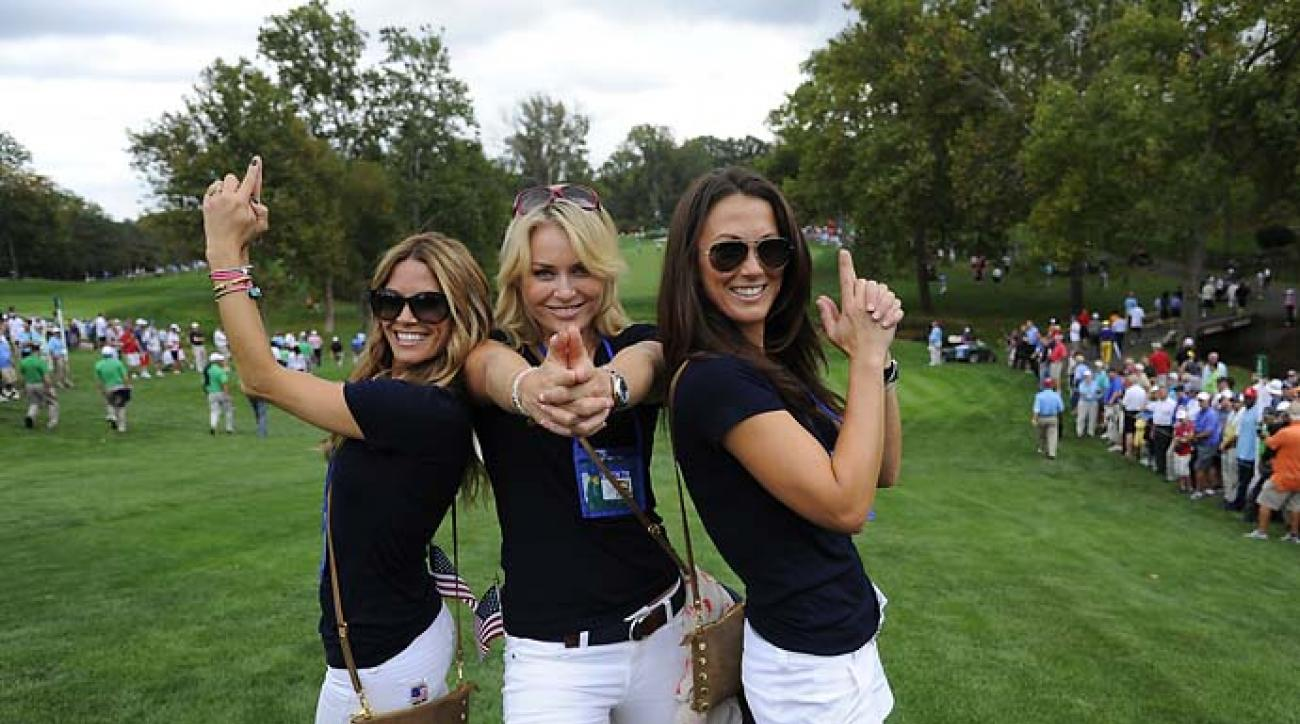 Sybi Kuchar, Lindsey Vonn and Fred Couples' girlfriend Nadine Moze strike a Hollywood pose during Day One of the Presidents Cup.