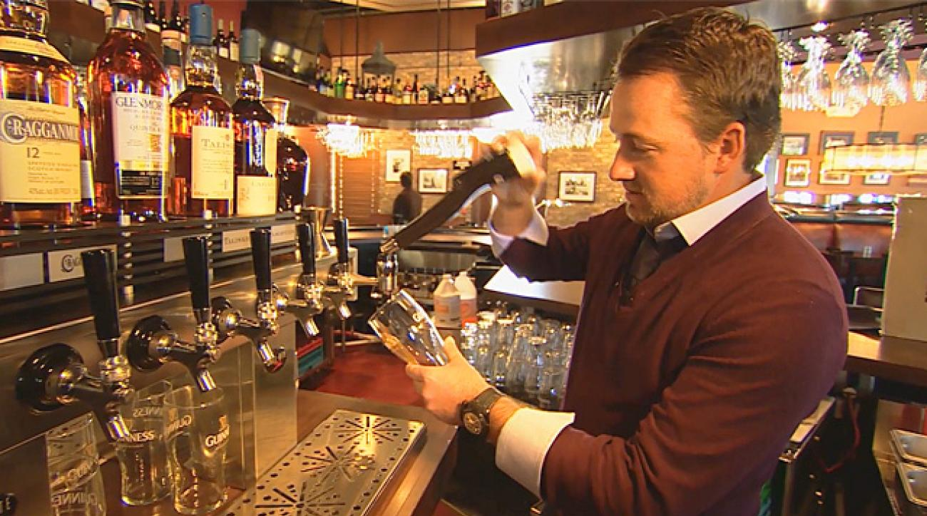 Graeme McDowell pours a perfect pint of Guinness
