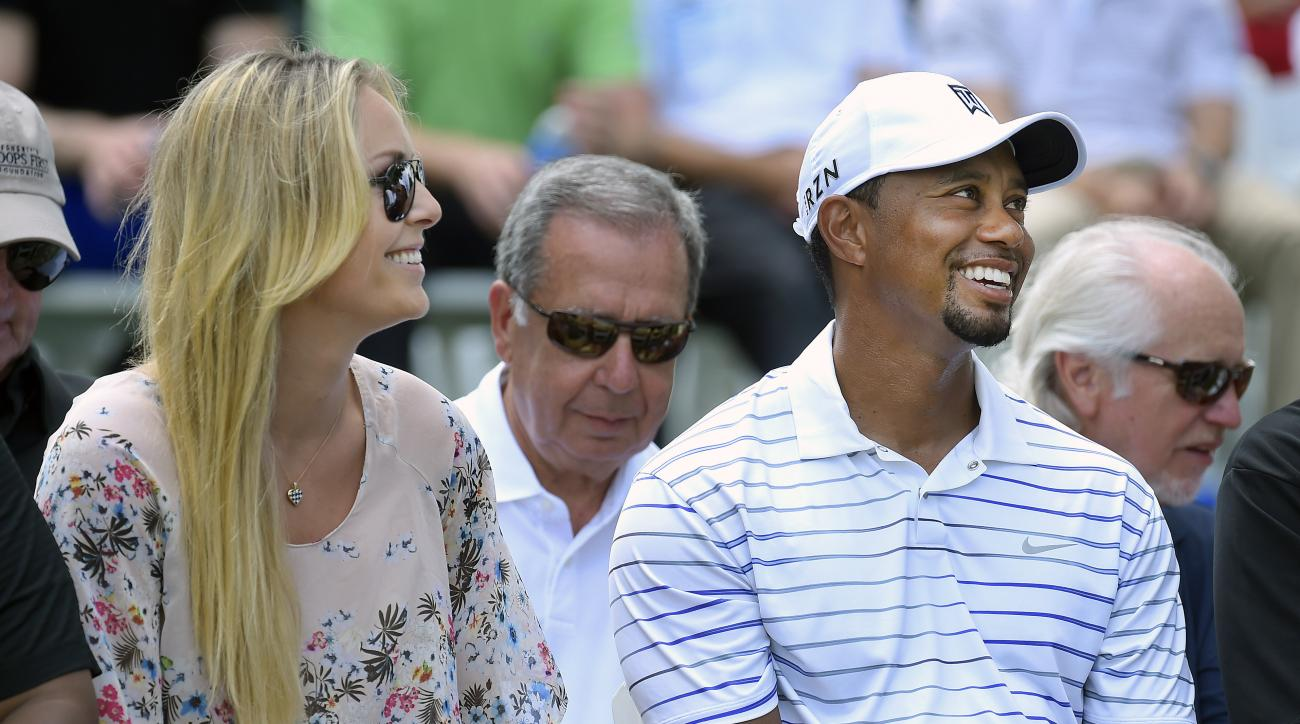 Lindsay Vonn and Tiger Woods at the Opening Ceremony for the Quicken Loans National at Congressional Country Club on June 25, 2014 in Bethesda, Maryland.