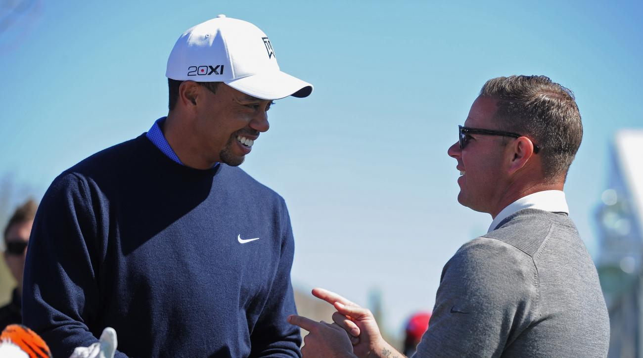 Tiger Woods talks with ex-coach Sean Foley during practice prior to the start of the 2013 World Golf Championships-Accenture Match Play Championship.