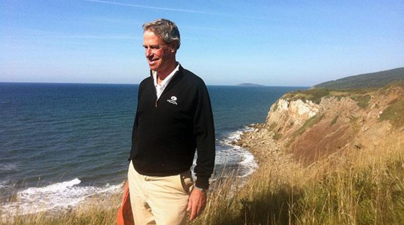 Mike Keiser surveys Cabot Cliffs in the fall of 2013.
