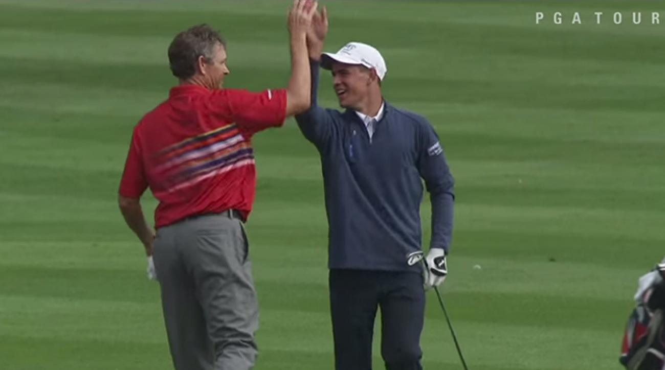 Christopher Meyers get a high-five from partner Lee Janzen after he sunk an albatross on 18.