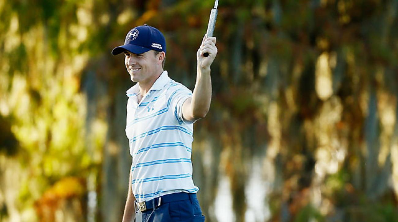 Jordan Spieth holes a 50-foot birdie putt on the 18th green to shoot a 9-under par 63 during the third round of the Hero World Challenge.