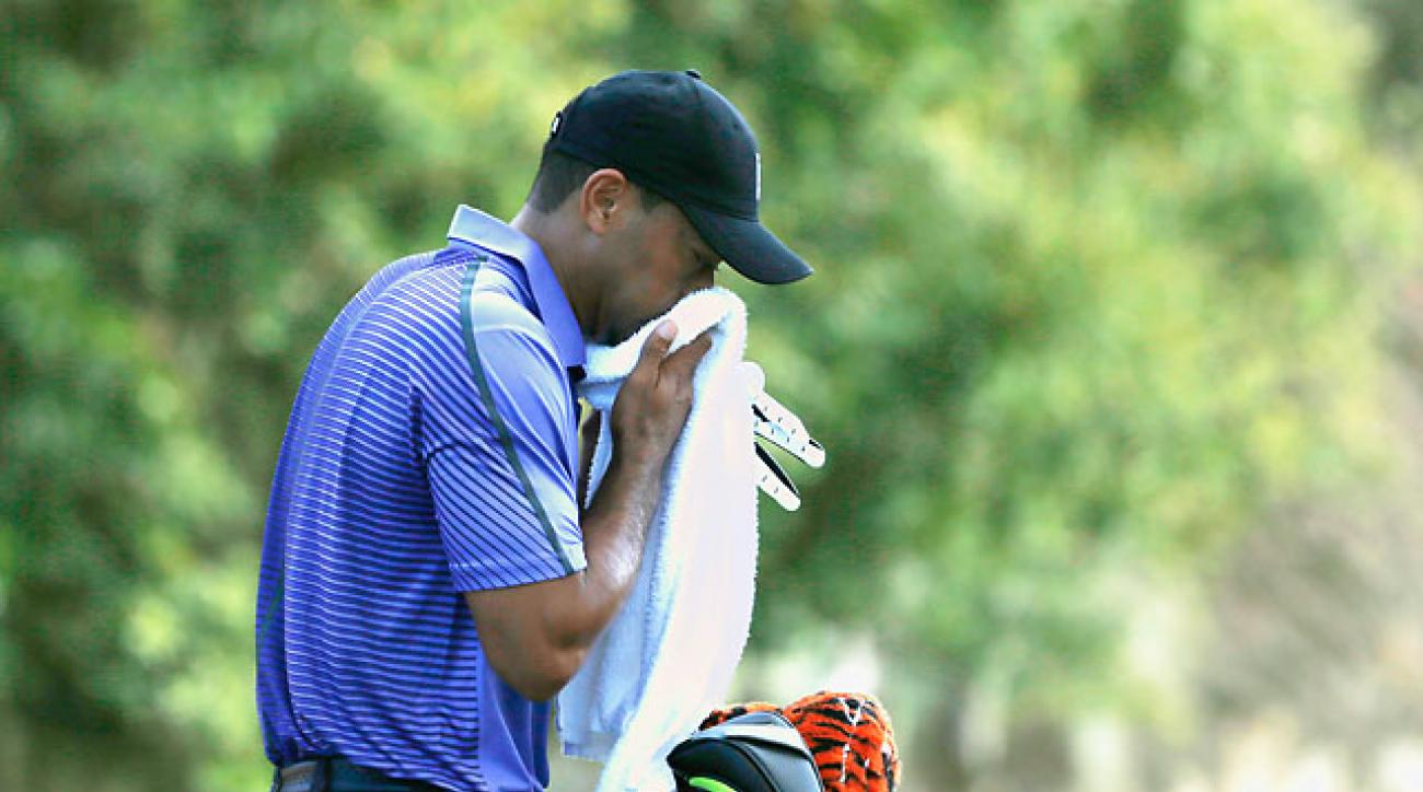 An ailing Tiger Woods waits on the second tee during the third round of the Hero World Challenge. Despite getting sick and running a fever, Woods shot a 3-under 69.