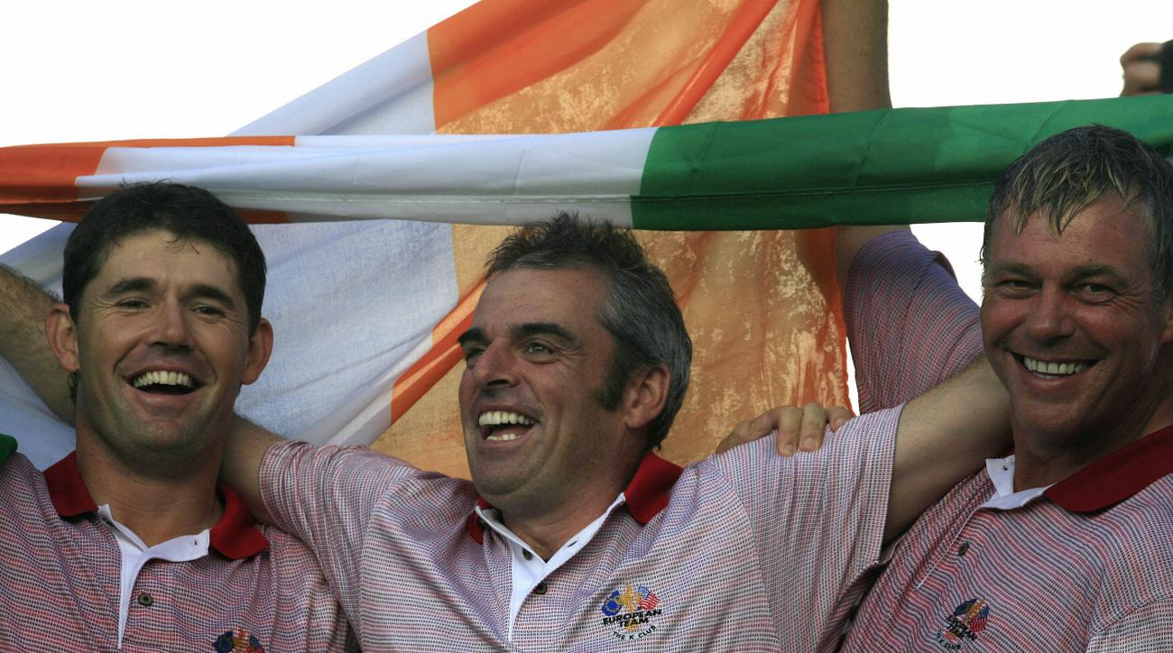 Former teammates Paul McGinley and Darren Clarke celebrate with the Irish flag after Europe retained the 2006 Ryder Cup over the United States.