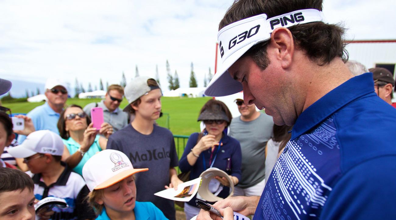 Bubba Watson signs autographs at Kapalua during the pro-am at the Tournament of Champions.