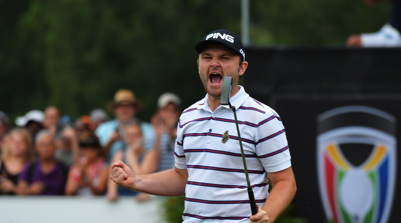 Andy Sullivan celebrates holing his putt to win the South African Open in a playoff with Charl Schwartzel.