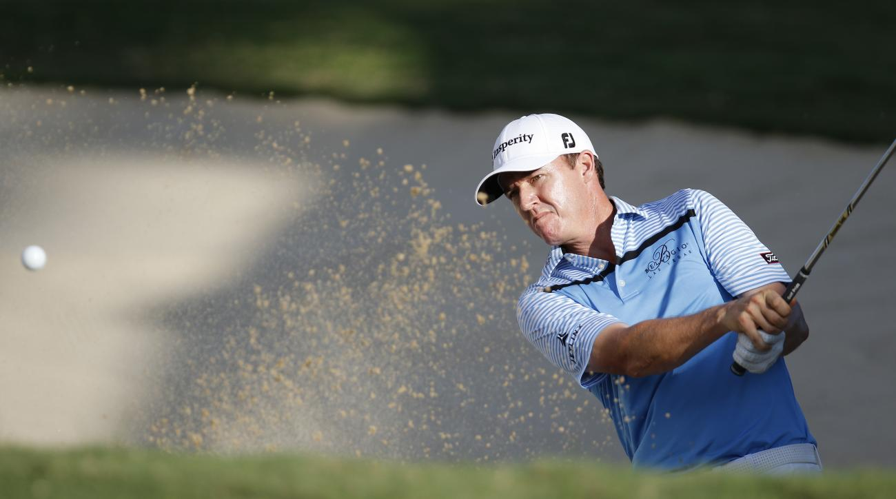 Jimmy Walker hits out of a bunker on the 17th green during the third round of the Sony Open golf tournament on Saturday.