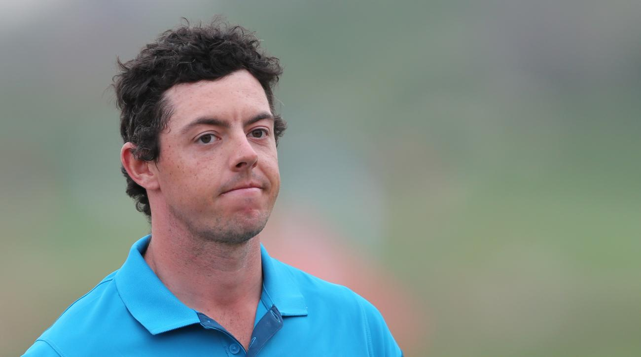 Rory McIlroy of Northern Ireland reacts on the hole 18th after he lost the final round of the Abu Dhabi HSBC Golf Championship in Abu Dhabi, United Arab Emirates, Sunday, Jan. 18, 2015. Gary Stal of France went on to win the championship. (AP