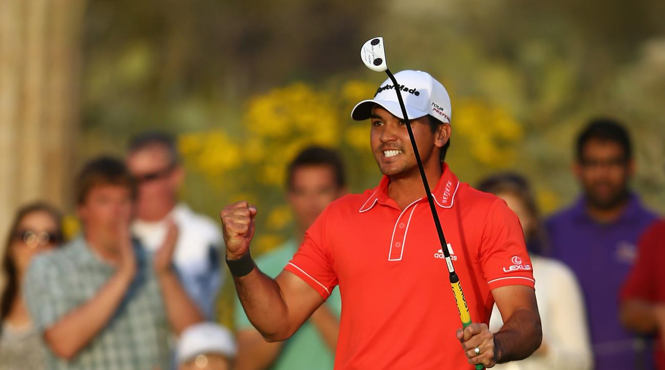 Jason Day celebrates his win at the 2014 Match Play Championship with a fist pump.