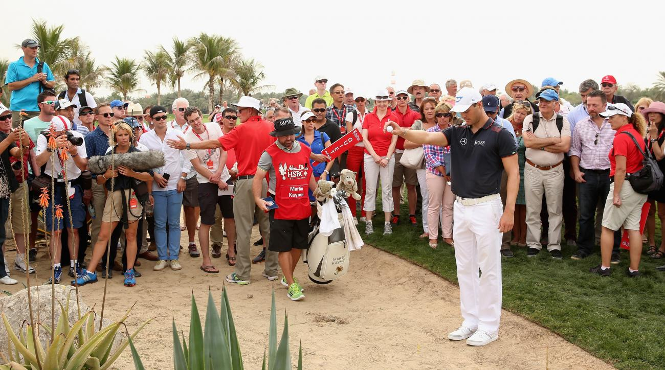 Martin Kaymer takes a drop on the ninth hole during the final round of the Abu Dhabi HSBC Golf Championship. He made a double-bogey 6 on the hole.