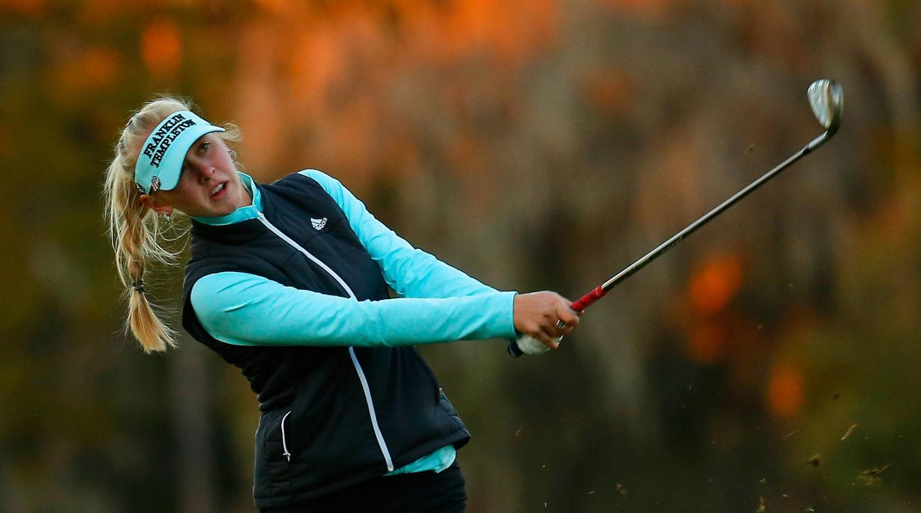 Jessica Korda hits her third shot on the 18th hole in the first round of the Coates Golf Championship in Ocala, Florida.