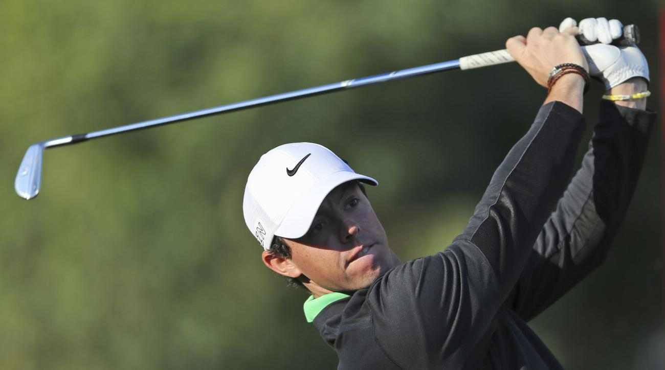 Rory McIlroy tees off on the 11th hole during the first round of the Dubai Desert Classic.