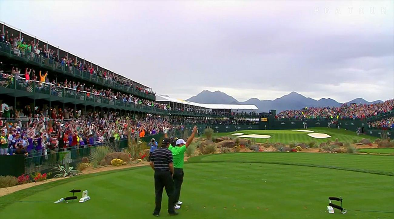 The crowd goes wild after Francesco Molinari's hole-in-one on the par-16th hole at TPC Scottsdale.