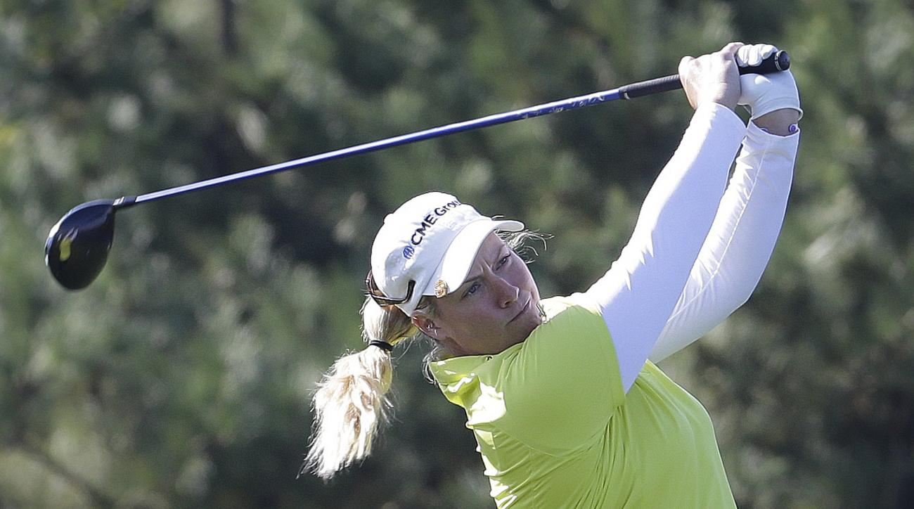 Brittany Lincicome of the United States watches her shot on the 4th hole during the second round of the LPGA KEB Hana Bank Championship golf tournament at Sky72 Golf Club in Incheon, South Korea, Friday, Oct. 17, 2014. (AP Photo/Ahn