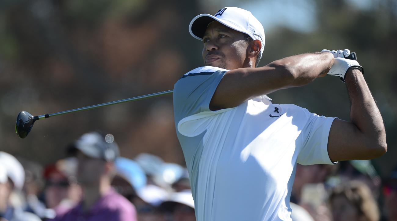 Tiger Woods tees off on the 10th hole during the first round of the Farmers Insurance Open at Torrey Pines.