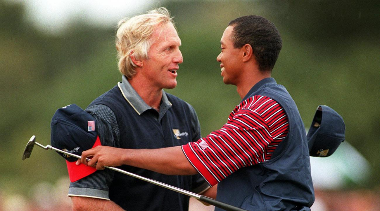 International Team member Greg Norman of Australia shakes hands with US Team member Tiger Woods after they went head to head at the 1998 Presidents Cup.