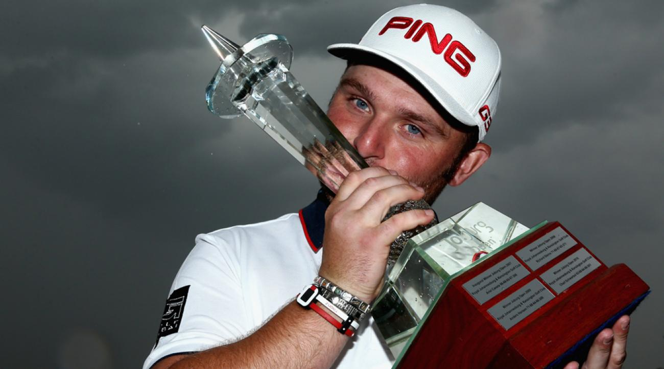 Andy Sullivan poses with the trophy after winning the Joburg Open at Royal Johannesburg and Kensington Golf Club Sunday in Johannesburg, South Africa.