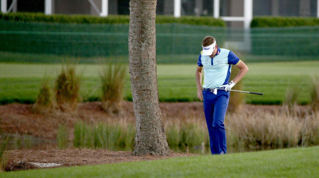 Ian Poulter lowers his head after a shot on the 14th hole during the final round of The Honda Classic at PGA National Resort & Spa on Monday in Palm Beach Gardens, Florida. Poulter lost five balls in his final round.