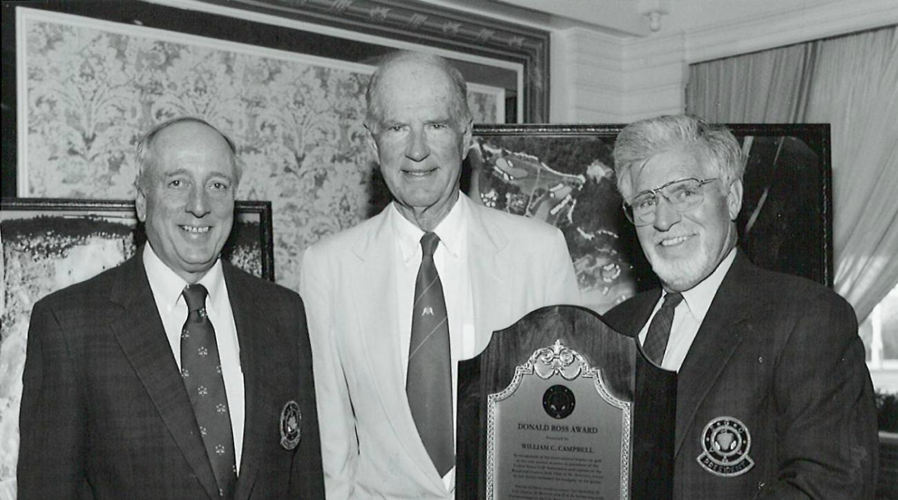 Jay Morrish (right) and Rees Jones (left) presented the American Society of Golf Course Architects' Donald Ross Award to Bill Campbell (center) in 2003.
