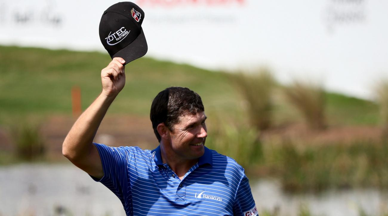 Padraig Harrington tips his hat to the crowd during the second playoff hole of The Honda Classic Monday in Palm Beach Gardens, Fla.