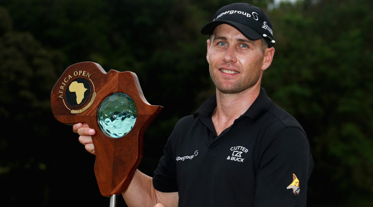 Trevor Fisher Jr. of South Africa poses with the trophy after winning the Africa Open at East London Golf Club Sunday in East London, South Africa.