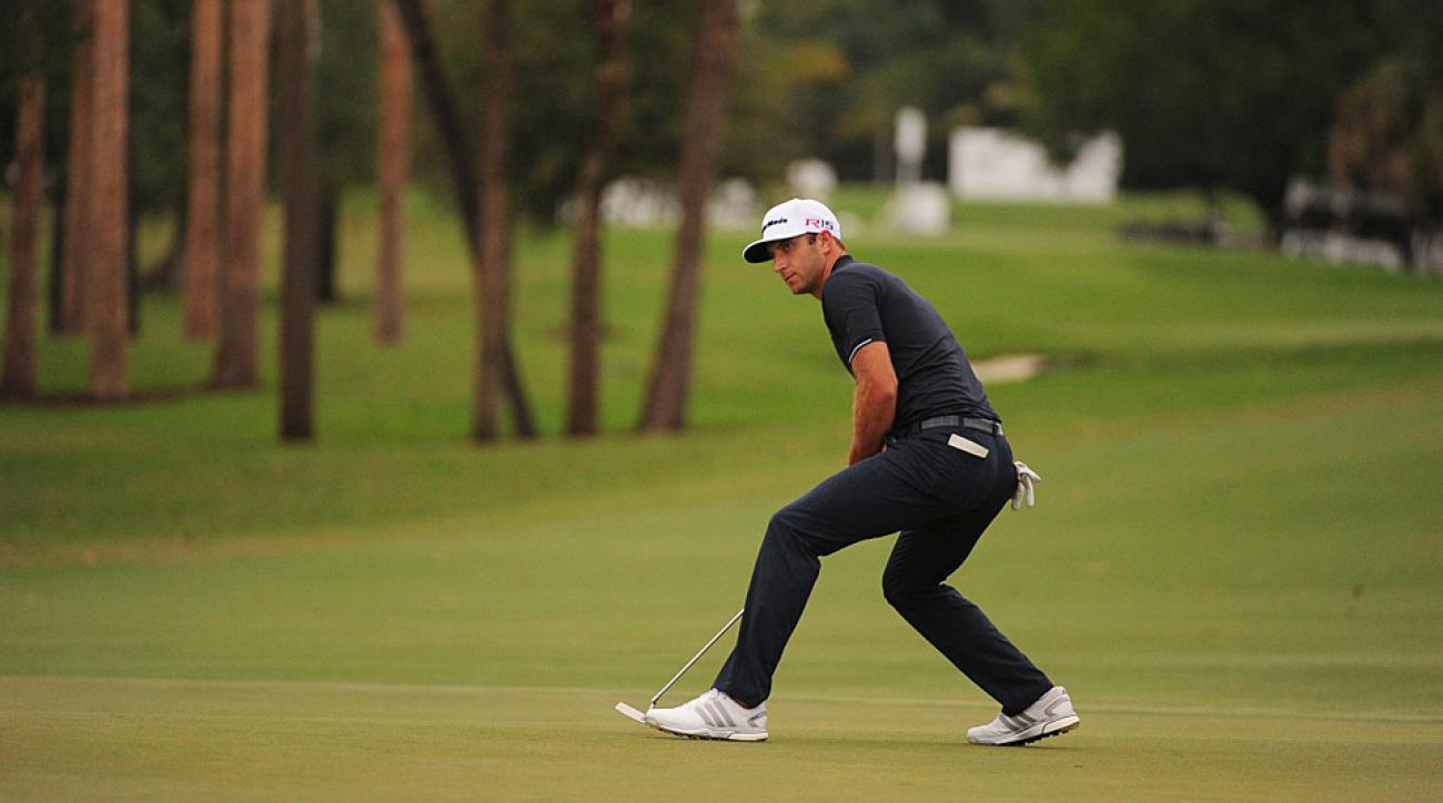 Dustin Johnson putts during his win at the 2015 WGC-Cadillac at Doral