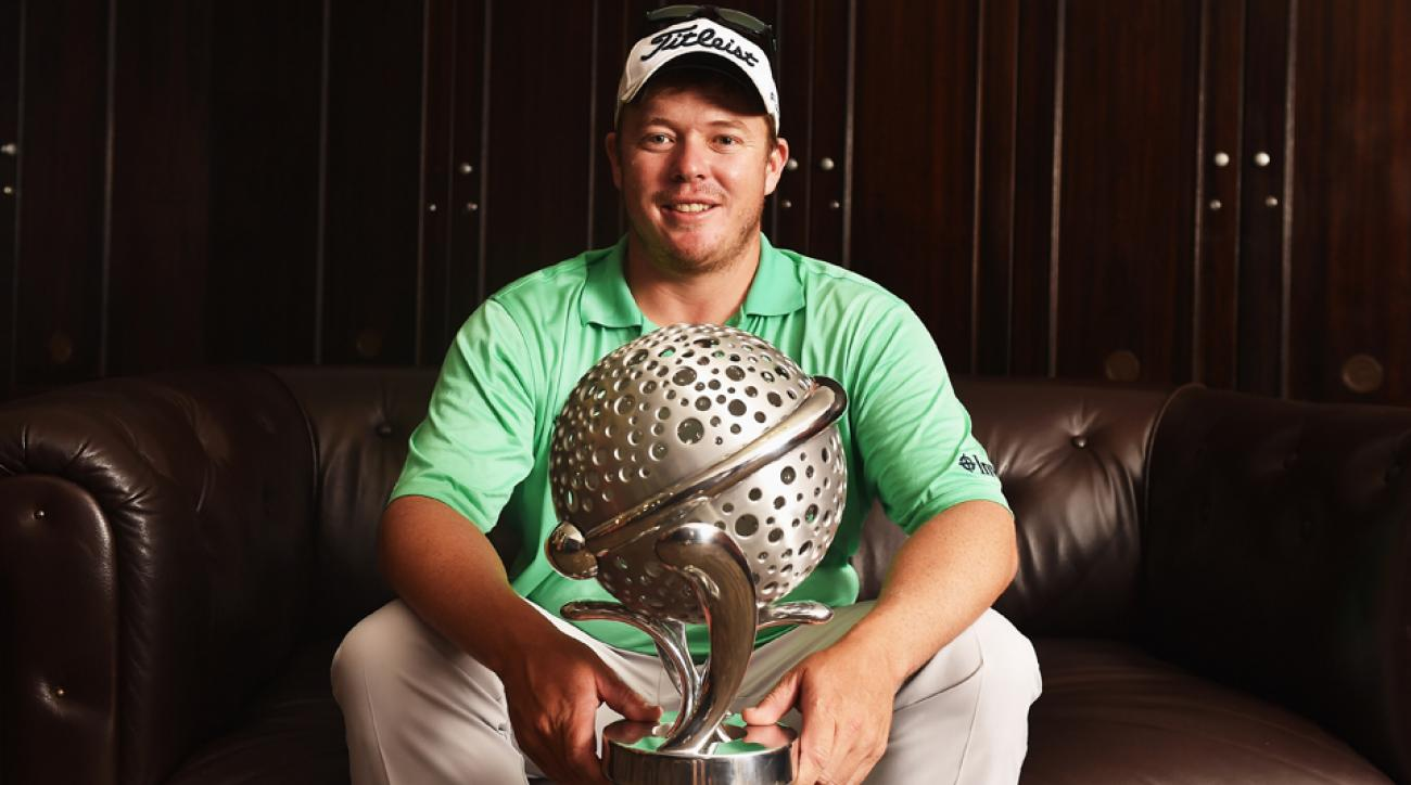 George Coetzee of South Africa poses for a picture with the trophy in the locker room after winning the Tshwane Open at Pretoria Country Club Sunday in Pretoria, South Africa.