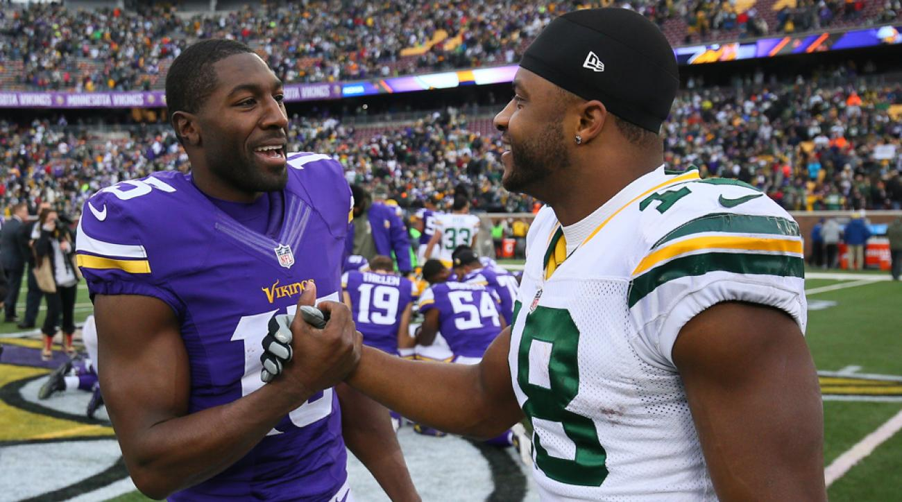 Greg Jennings (left) talks with former teammate Randall Cobb after the Vikings and Packers played on Nov. 23, 2014, at TCF Bank Stadium in Minneapolis.