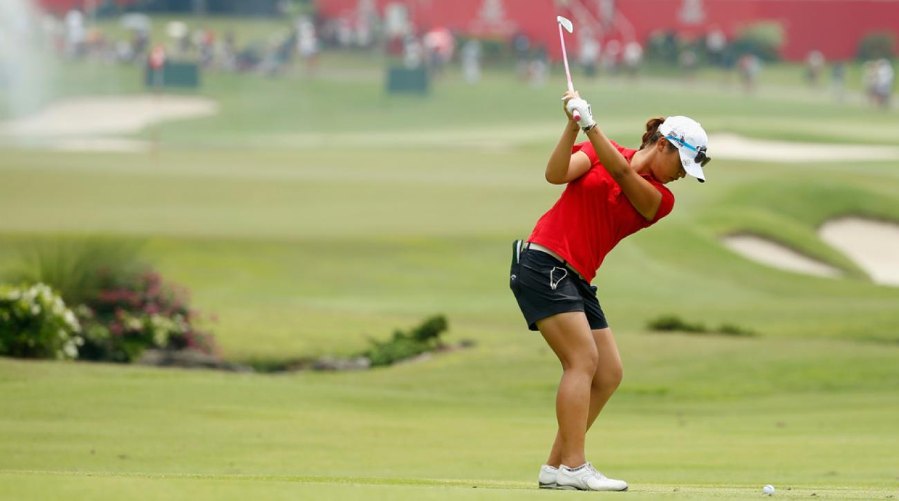 Lydia Ko of New Zealand hits her approach shot on the 16th hole during the final round of the HSBC Women's Champions at the Sentosa Golf Club March 8, 2015, in Singapore.