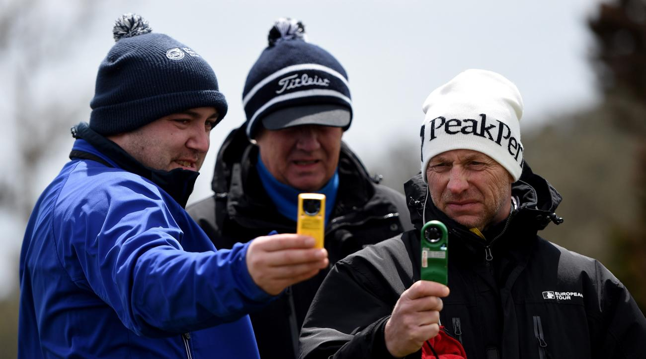 European Tour meteorologist Guy Nestor and European Tours referee's Thomas Waldenstedt and Mikael Eriksson check the wind speed during the delayed the first round of the 2015 Madeira Islands Open.